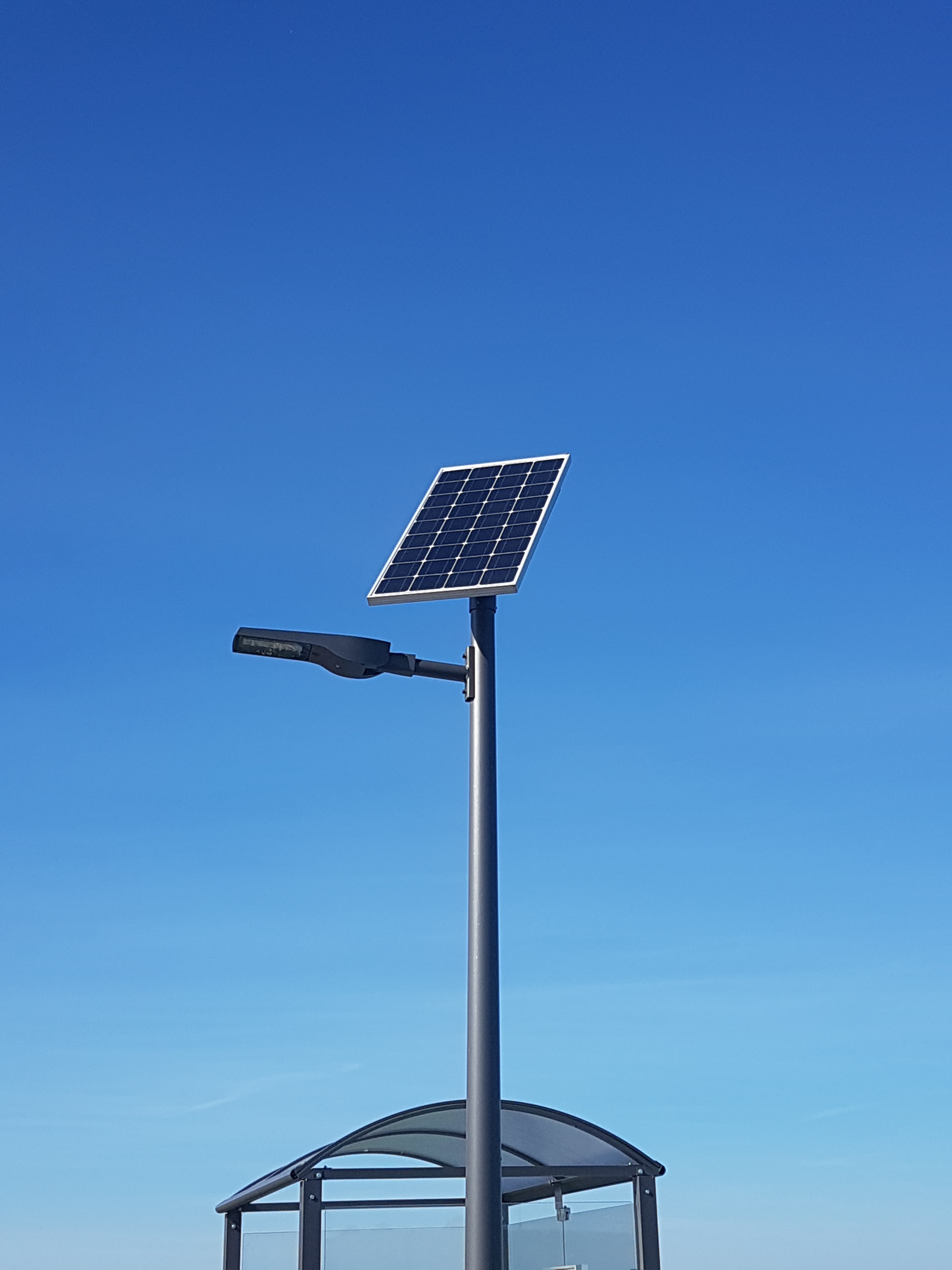 A SOLAR STREET LAMP TO ILLUMINATE THE STOP FOR TRAVELERS OF